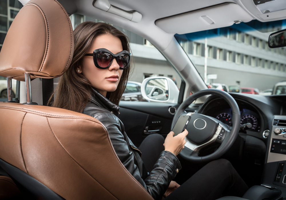 female driver wearing sunglasses